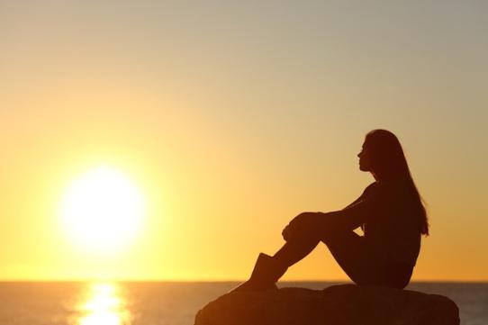 Woman-Sitting-Alone